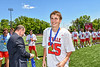 Baldwinsville Bees Christian Petragnani (25) receiving his NYSPHSAA Section III Class A Boys Lacrosse championship medal at the Pelcher-Arcaro Stadium in Baldwinsville, New York on Saturday, June 12, 2021.