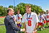 Baldwinsville Bees Austin McClintic (8) receiving his NYSPHSAA Section III Class A Boys Lacrosse championship medal at the Pelcher-Arcaro Stadium in Baldwinsville, New York on Saturday, June 12, 2021.