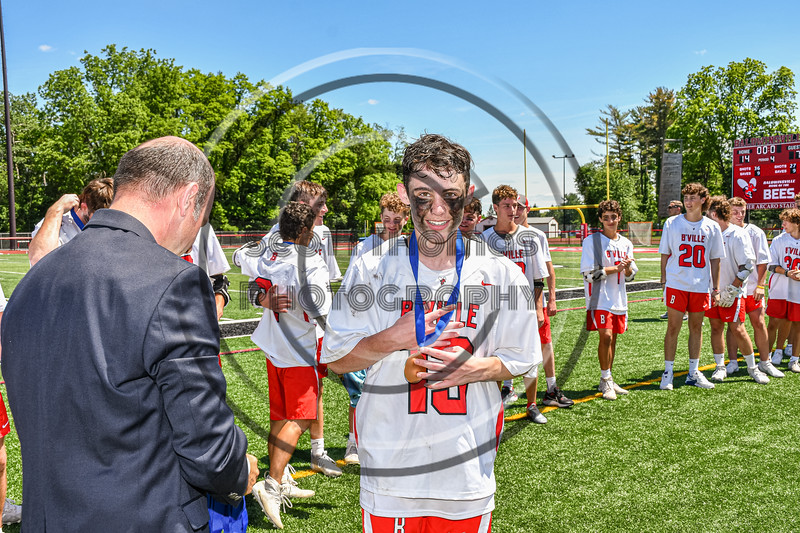 Baldwinsville Bees Keegan Lynch (13) receiving his NYSPHSAA Section III Class A Boys Lacrosse championship medal at the Pelcher-Arcaro Stadium in Baldwinsville, New York on Saturday, June 12, 2021.