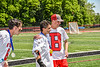 Baldwinsville Bees Victor Ianno (2) and Jason Ordway celebrating the NYSPHSAA Section III Class A Boys Lacrosse championship at the Pelcher-Arcaro Stadium in Baldwinsville, New York on Saturday, June 12, 2021.