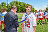 Baldwinsville Bees Patrick Otts (32) receiving his NYSPHSAA Section III Class A Boys Lacrosse championship medal at the Pelcher-Arcaro Stadium in Baldwinsville, New York on Saturday, June 12, 2021.