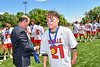 Baldwinsville Bees Brayden Penafeather-Stevenson (21) receiving his NYSPHSAA Section III Class A Boys Lacrosse championship medal at the Pelcher-Arcaro Stadium in Baldwinsville, New York on Saturday, June 12, 2021.