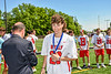 Baldwinsville Bees Cole Schuyler (20) receiving his NYSPHSAA Section III Class A Boys Lacrosse championship medal at the Pelcher-Arcaro Stadium in Baldwinsville, New York on Saturday, June 12, 2021.