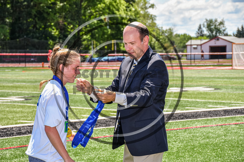 Cicero-North Syracuse Northstars XXXX receiving her NYSPHSAA Section III Class A Girls Lacrosse championship medal at the Pelcher-Arcaro Stadium in Baldwinsville, New York on Saturday, June 12, 2021.