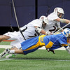 Ridgewood High School defensemen Dave Tarleton (7) and Pat Kiernan (26) battle for contol of the ball with Springfield (PA) High School attackman Colin Keegan (19) in the opening game of the college Big City Classic lacrosse tournament at Giants stadium, won by Springfield 8-5.<br /> PHOTO: KELLY BIRDSEYE