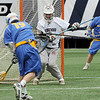 Ridgewood High School goaltender Brad Macnee (net) can't stop a ball fired by Springfield (PA) High School attackman Colin Keegan (19) in the opening game's third quarter of the college Big City Classic lacrosse tournament at Giants stadium, won by Springfield 8-5.<br /> PHOTO: KELLY BIRDSEYE