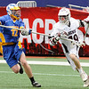 Ridgewood High School attackman Mike Giordano (19) drives past Springfield (PA) High School defenseman Brendan Nave in the opening game of the college Big City Classic lacrosse tournament at Giants stadium, won by Springfield 8-5.<br /> PHOTO: KELLY BIRDSEYE<br /> PHOTO: KELLY BIRDSEYE