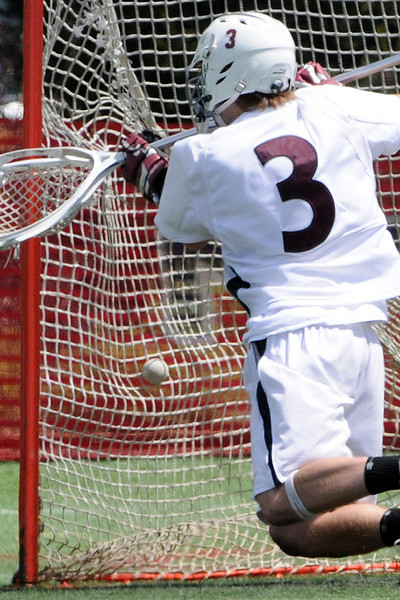 03/24/2010...Ridgewood goalie Alex Branton had 16 saves against Delbarton but this was one of 8 shots that got passed him.<br /> PHOTO: KELLY BIRDSEYE