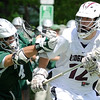 "03/24/2010...Ridgewood's Vann ""Dolphin"" Jorgensen (12) looks to pass with pressure from Anthony Heaton of Delbarton.<br /> PHOTO: KELLY BIRDSEYE"