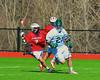 Marcellus Mustangs Jason Decker (21) being chased by Baldwinsville Bees William Hamm Jr. (7) on Saturday, March 30, 2013. Baldwinsville won 6-5.