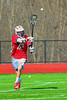 Baldwinsville Bees Connor Chapman (12) passes the ball against the Marcellus Mustangs on Saturday, March 30, 2013. Baldwinsville won 6-5.