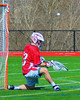 Baldwinsville Bees goalie Parker Ferrigan (23) makes a save against the Marcellus Mustangs on Saturday, March 30, 2013. Baldwinsville won 6-5.