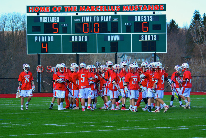 Baldwinsville Bees celebrate a come from behind victory over the Marcellus Mustangs on Saturday, March 30, 2013. Baldwinsville won 6-5.