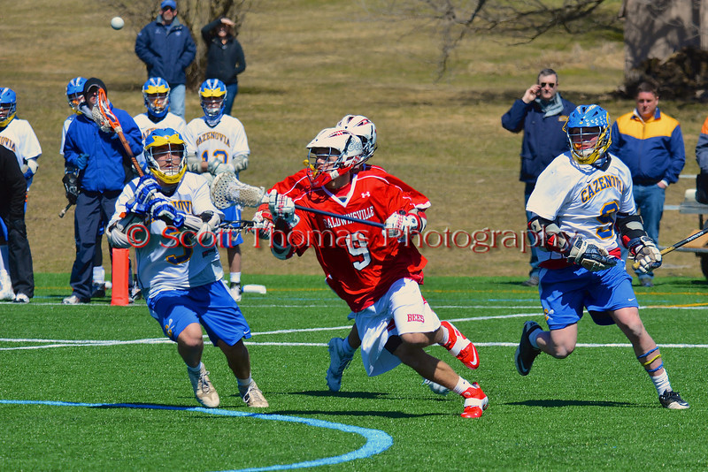 Baldwinsville Bees Stephen Petrelli (9) goes after a loose ball against the Cazenovia Lakers on Saturday, April 6, 2013. Cazenovia won 5-4 in Double Overtime.