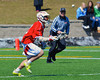 Baldwinsville Bees Nathan Rutkowski (13) tracking down a loose ball against the Cazenovia Lakers on Saturday, April 6, 2013. Cazenovia won 5-4 in Double Overtime.