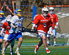 Baldwinsville Bees John Walker (5) taking the ball away from a Cazenovia Lakers player on Saturday, April 6, 2013. Cazenovia won 5-4 in Double Overtime.