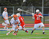 Liverpool Warriors Jamie Kuppel (19) working against Baldwinsville Bees defenders John Walker (5) and Matthew Paddock (21) on Tuesday, April 9, 2013.