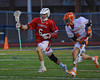 Baldwinsville Bees Ronnie Bertrand (6) runs past a Liverpool Warriors player on Tuesday, April 9, 2013.