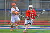Baldwinsville Bees Connor Chapman (12) working against a Liverpool Warriors defender on Tuesday, April 9, 2013.