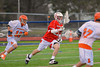 Baldwinsville Bees Parker Ferrigan (23) bringing the ball up filled against the Liverpool Warriors on Tuesday, April 9, 2013.
