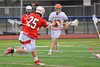 Baldwinsville Bees Kyle Akers (25) fires a shot at the Liverpool Warriors net on Tuesday, April 9, 2013.
