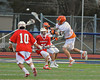 Liverpool Warriors Peter Flood (18) fires a shot at the Baldwinsville Bees net on Tuesday, April 9, 2013.