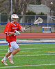 Baldwinsville Bees Stephen Petrelli (9) passes the ball against the Liverpool Warriors on Tuesday, April 9, 2013. Petrelli scored the winning goal in overtime as the Bees upset the Warriors, 7-6.