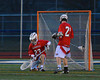 Baldwinsville Bees goalie Parker Ferrigan (23) makes a save against the Liverpool Warriors on Tuesday, April 9, 2013.