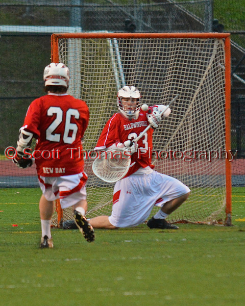 Baldwinsville Bees goalie Parker Ferrigan (23) makes a save on a shot by a Syracuse East player on Tuesday, April 16, 2013. Baldwinsville Bees won 14-5.