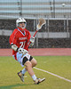 Baldwinsville Bees Matt Zandri (22) passes the lacrosse ball through the rain against Syracuse East on Tuesday, April 16, 2013. Baldwinsville Bees won 14-5.