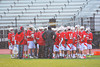 Baldwinsville Bees huddle up after the first quarter of play against Syracuse East on Tuesday, April 16, 2013. Baldwinsville Bees won 14-5.