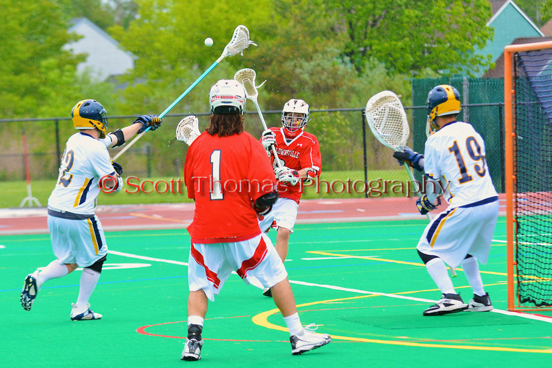 Baldwinsville Bees Stephen Petrelli (9) passes to Zachary Bulak (1) in front of the West Genesee Wildcats net guarded by Matt Koziol (19) in Class A Boys Lacrosse Section III Semi-finals at the Michael J. Bragman stadium in Cicero, New York. West Genesee won 9-8.