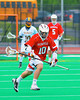 Baldwinsville Bees Eric Candee (10) bringing the ball upfield against the West Genesee Wildcats in Class A Boys Lacrosse Section III Semi-finals at the Michael J. Bragman stadium in Cicero, New York. West Genesee won 9-8.