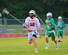 Baldwinsville Bees Clayton Messmer (29) bringing the ball upfield with a Cicero-North Syracuse Northstars player in pursuit in Class A quarterfinal Section III Boys Lacrosse action at the Pelcher-Arcaro Stadium in Baldwinsville, New York.