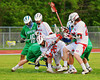 Baldwinsville Bees Luke McCaffrey (20) comes out of a face-off scrum with the ball which lead to the second Bees goal against the Cicero-North Syracuse Northstars in Class A quarterfinal Section III Boys Lacrosse action at the Pelcher-Arcaro Stadium in Baldwinsville, New York.