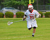 Baldwinsville Bees Matthew Paddock (21) bringing the ball upfield against the Cicero-North Syracuse Northstars in Class A quarterfinal Section III Boys Lacrosse action at the Pelcher-Arcaro Stadium in Baldwinsville, New York.
