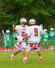 Baldwinsville Bees Ronnie May (26) high fives Stephen Petrelli (9) after a goal against the Cicero-North Syracuse Northstars in Class A quarterfinal Section III Boys Lacrosse action at the Pelcher-Arcaro Stadium in Baldwinsville, New York.