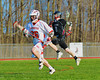 Baldwinsville Bees Ronnie May (26) bringing the ball up field against the Corcoran Cougars in Section III Boys Lacrosse action at the Pelcher-Arcaro Stadium in Baldwinsville, New York.  Baldwinsville won 10-1.