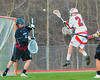 Baldwinsville Bees Sean Barron (24) fires in a goal past Corcoran Cougars goalie Noah Galvan (4) in Section III Boys Lacrosse action at the Pelcher-Arcaro Stadium in Baldwinsville, New York.  Baldwinsville won 10-1.