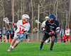 Baldwinsville Bees Patrick Heller (14) looking to get past Corcoran Cougars Keison Cannon (2) in Section III Boys Lacrosse action at the Pelcher-Arcaro Stadium in Baldwinsville, New York.  Baldwinsville won 10-1.