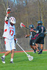 Baldwinsville BeesAustin McAskill (17) raises his arm in celebration after scoring against the Corcoran Cougars in Section III Boys Lacrosse action at the Pelcher-Arcaro Stadium in Baldwinsville, New York.  Baldwinsville won 10-1.