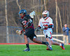 Corcoran Cougars Emilio Booker (15) getting past Baldwinsville Bees Luke McCaffrey (20) in Section III Boys Lacrosse action at the Pelcher-Arcaro Stadium in Baldwinsville, New York.  Baldwinsville won 10-1.