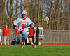 Baldwinsville Bees defensemen Scott Kirchner (11) looking to get the ball upfield against the Corcoran Cougars in Section III Boys Lacrosse action at the Pelcher-Arcaro Stadium in Baldwinsville, New York.  Baldwinsville won 10-1.