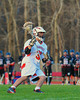 Baldwinsville Bees David Bird (38) with the ball against the Corcoran Cougars in Section III Boys Lacrosse action at the Pelcher-Arcaro Stadium in Baldwinsville, New York.  Baldwinsville won 10-1.