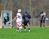 Baldwinsville Bees Austin McAskill (17) fires in the first goal against the Corcoran Cougars in Section III Boys Lacrosse action at the Pelcher-Arcaro Stadium in Baldwinsville, New York.  Baldwinsville won 10-1.
