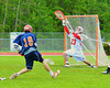 Liverpool Warriors Jamie Kuppel (19) beats Baldwinsville Bees goalie Parker Ferrigan (23) for one of his three goals in Section III Boys Lacrosse action at the Pelcher-Arcaro Stadium in Baldwinsville, New York.  Bees won 10-6.