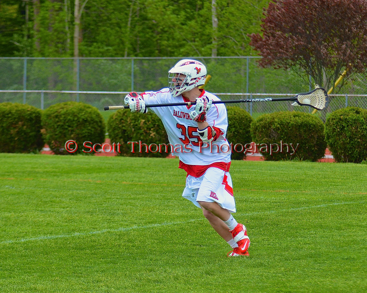 Baldwinsville Bees Brian Whelan (35) looking to make a pass against the Liverpool Warriors in Section III Boys Lacrosse action at the Pelcher-Arcaro Stadium in Baldwinsville, New York.  Bees won 10-6.