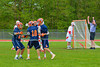 Liverpool Warriors players congratulate Peter Flood (18) on his gaol against the Baldwinsville Bees in Section III Boys Lacrosse action at the Pelcher-Arcaro Stadium in Baldwinsville, New York.  Bees won 10-6.