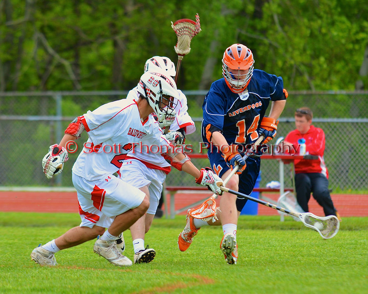 Baldwinsville Bees Luke McCaffrey (20) gets to a loose ball before Liverpool Warriors Dustin Springer (14) in Section III Boys Lacrosse action at the Pelcher-Arcaro Stadium in Baldwinsville, New York.  Bees won 10-6.