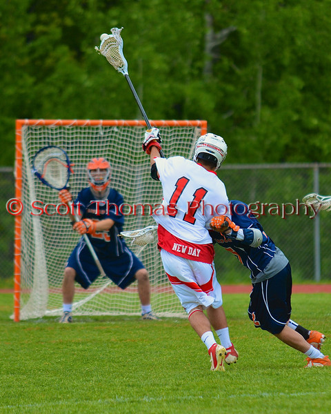 Baldwinsville Bees Scott Kirchner (11) takes a shot at the Liverpool Warriors net in Section III Boys Lacrosse action at the Pelcher-Arcaro Stadium in Baldwinsville, New York.  Bees won 10-6.